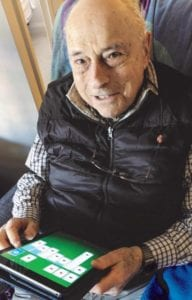 senior citizen using ipad