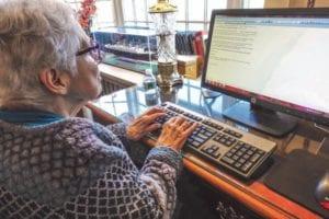 senior citizen on computer